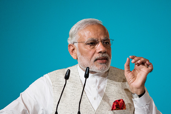 Narendra Modi, India's prime minister, speaks during the 37th Singapore Lecture held at the Shangri-La Hotel in Singapore, on Monday, Nov. 23, 2015. Modi's government, which in February pushed back its deadline for fiscal consolidation by a year to March 2018, faces a higher wage bill just as a sluggish economy and dwindling asset sales are weighing on revenue. Photographer: Nicky Loh/Bloomberg via Getty Images