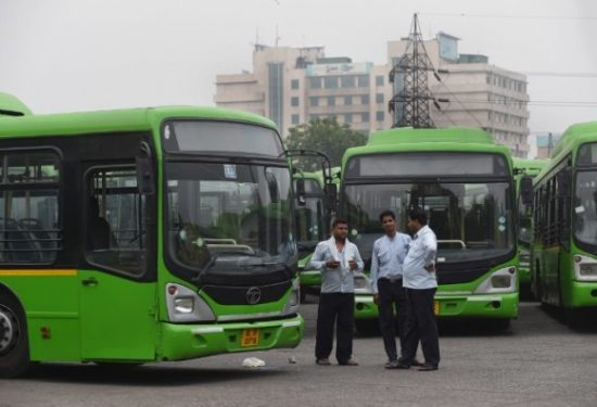 Indian bus drivers as buses of Delhi Transport Corporation (DTC) are parked in a depot following a strike in New Delhi on May 11, 2015. A day after a driver of the Delhi Transport Corporation (DTC) was beaten to death allegedly by a biker in a case of road rage, drivers of the state-run bus service have called a strike, causing problems for thousands of commuters and schoolchildren. Ashok Kumar, 42, died on the morning of May 10, 2015 after Vijay, a young man whose bike he had grazed, climbed onto his bus and allegedly bludgeoned him with his helmet. Investigations suggest Vijay and his mother fell when the bus hit their motorcycle.   AFP PHOTO/ PRAKASH SINGH / AFP / PRAKASH SINGH